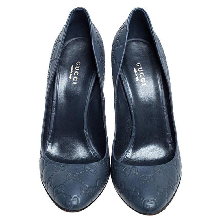 Create a sophisticated look with this pair of pumps from Gucci. The blue leather pumps with GG embossing feature covered toes, gold-tone detailing on the heel seat and 12 cm heels. Add a unique touch to your style by donning this pair of