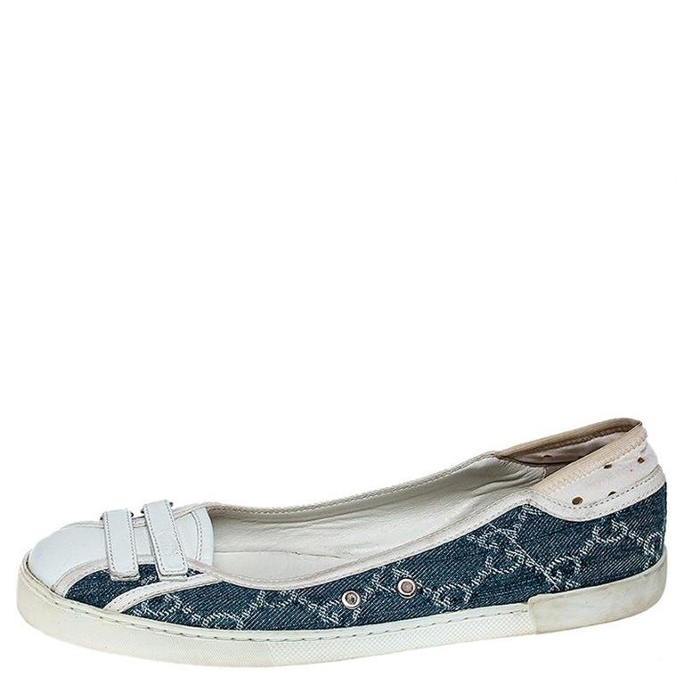 The flats are designed from monogram denim and white leather to offer luxury. They feature velcro straps on the uppers and leather insoles for your ease. Gucci understands your need for comfort and style in these flats.  Includes: The Luxury Closet