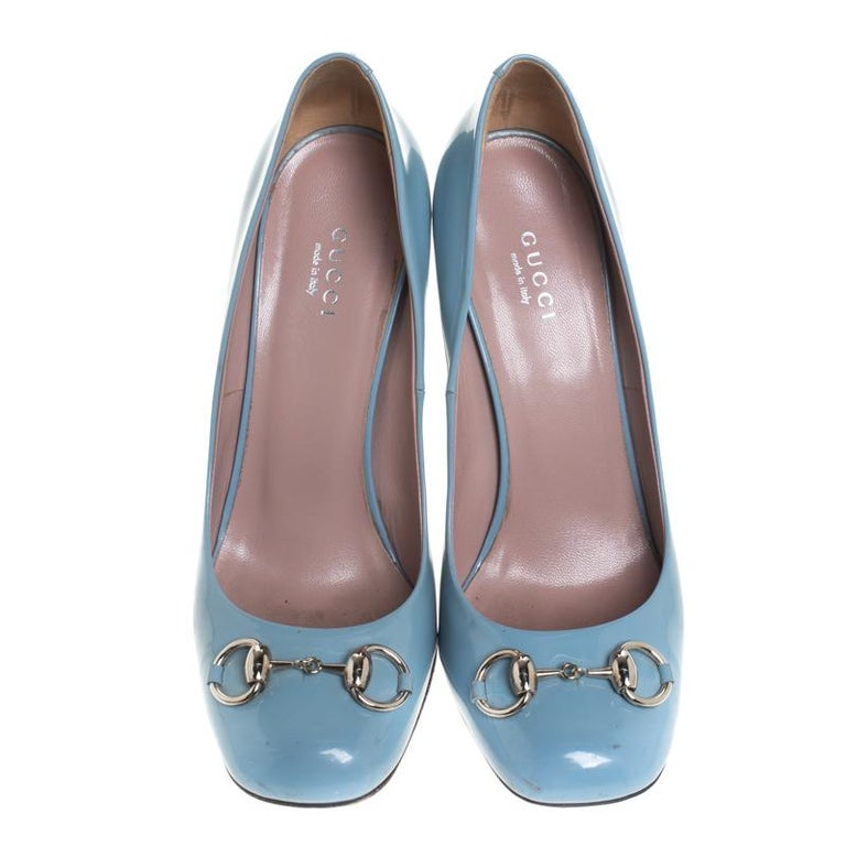 Featuring a chic, minimalist design, these Jolene pumps from Gucci are easy to style. Blue patent leather uppers showcase silver-tone signature Gucci horsebit accents on the vamps. High stiletto heels and square toes form a distinctive outline.