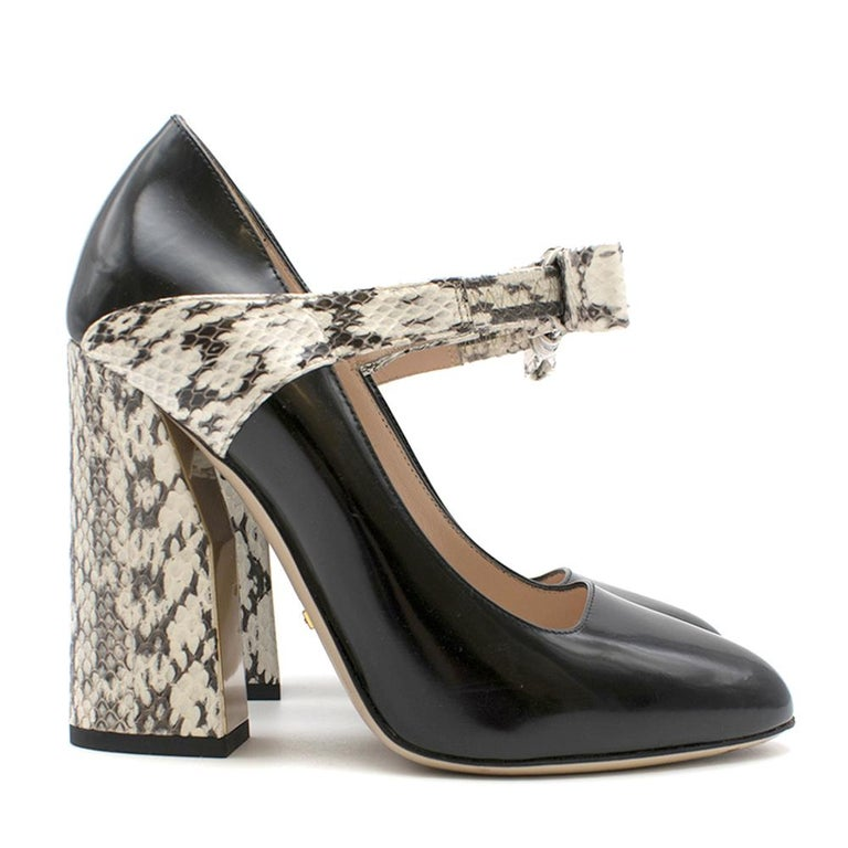 Gucci Bow-embellished elaphe and leather pumps.   - Combination of elaphe and patent leather  - Block heel - Bow-embellished ankle strap   Please note, these items are pre-owned and may show signs of being stored even when unworn and unused. This is
