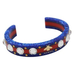 Gucci bracelet in red and blue plastic, with with a bee and rhinestones