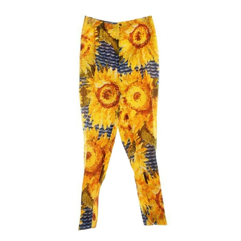 Gucci silk trousers feature bright sunflower print and an elegant cropped leg, center pressed.  Made in Italy.  Material: 100% Silk. Size : 42 Italian (It fits like 38EU, 6-8US) Measurements :  Waist : 32 cm Length : 95 cm Width ankle : 16 cm