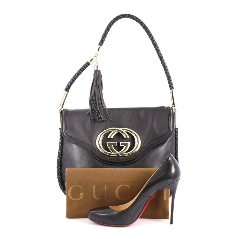 c7c12a31fa28 This Gucci Britt Tassel Flap Bag Leather Medium, crafted in black leather,  features a