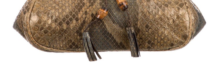 Snakeskin Bamboo Gold tone hardware Leather lining Turnlock closure Made in Italy Measures 7.5
