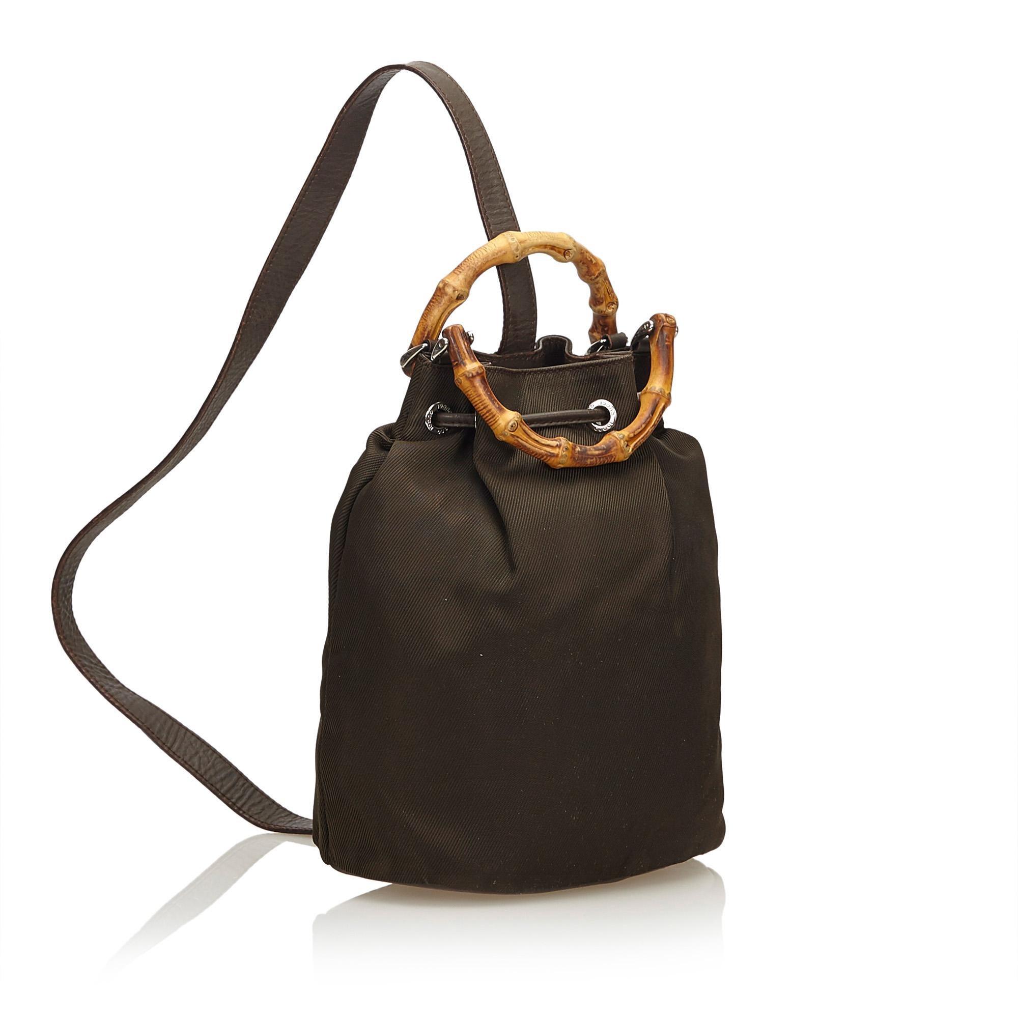 89a2e4b31dbfe0 Gucci Brown Bamboo Nylon Drawstring Backpack at 1stdibs