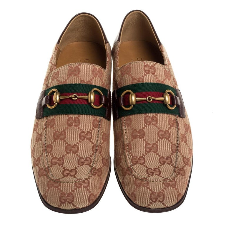 Perfect for outlining suave and debonair looks, these slip-on loafers from Gucci are definitely worth buying. They come crafted from GG canvas & leather in classy brown & beige shades and styled with the signature web and gold-tone horsebit details