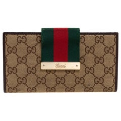 Gucci Brown/Beige GG Canvas and Leather Web Flap Continental Wallet