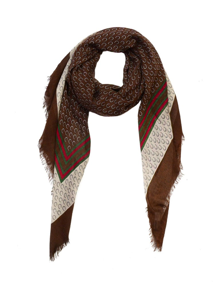 Gucci Brown Cashmere/Wool Horseshoe Print Scarf W/ Red/Green Trim   Made In:  Italy Color: Brown, tan, red/green Materials: 90% modal, 10% cashmere Overall Condition: Very good pre-owned condition with exception of some pulls in