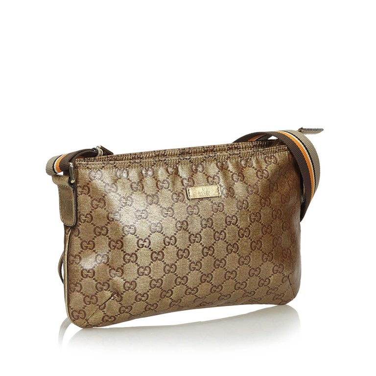 3e0ad621d613 Gucci Brown GG Supreme Coated Canvas Crossbody Bag For Sale. This crossbody  bag features a coated canvas body, a flat web strap, a top