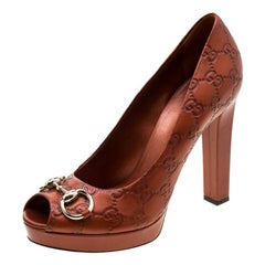 Gucci Brown Guccissima Leather Horsebit Peep Toe Platform Pumps Size Size 40.5