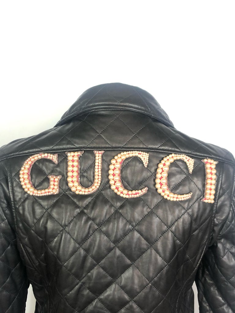 """GUCCI Brown Leather Moto Jacket w/ Pearls Size 44  Product details: Size is 44 Shoulder to shoulder measures 16.5"""" Brown stitched leather jacket  featuring silver-tone metal detail, all stamped with GUCCI sign Double buckles on each side  Zipper"""