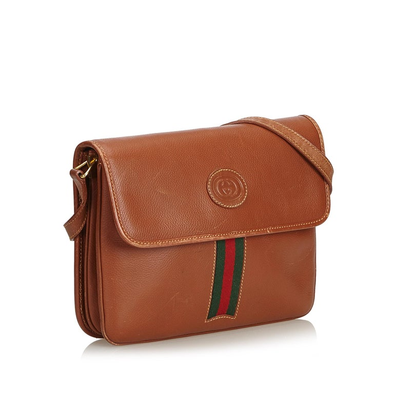 de5a8a481d5 Gucci Brown Leather Web Crossbody Bag For Sale. This crossbody bag features  a leather body