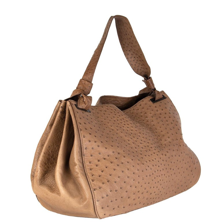 Gucci large tote bag in pale brown ostrich leather. Lined in ochre monogram canvas with one zip pocket against the back. Has been carried with some soft color transfer, bag is slightly darker on the buttom. Overall in excellent condition.