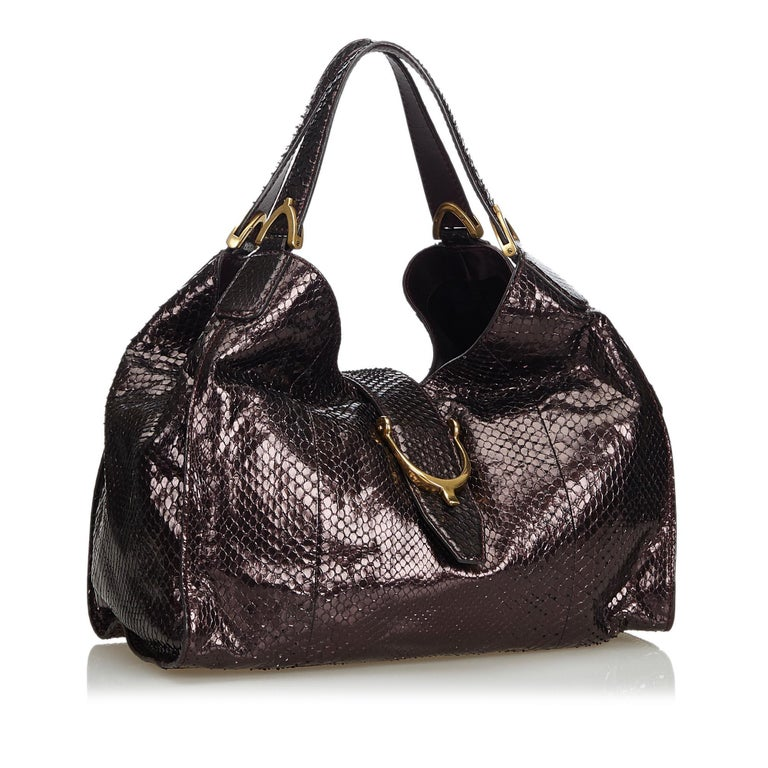 This shoulder bag features a python leather body, flat straps, an open top with a flat strap, and interior zip and slip pockets. It carries as AB condition rating.  Inclusions:  This item does not come with inclusions.  Dimensions: Length: 28.00