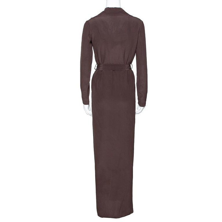 Sophisticated and posh, this stylish number by Gucci has been designed to deliver style goals that will never be forgotten. Crafted from pure silk, this luxurious item carries a solid brown exterior. It is equipped with a v-neck, button-down front,