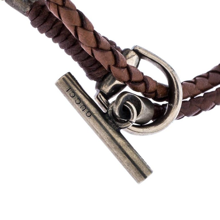 How chic and stylish is this wrap bracelet from Gucci! It is woven from brown leather and features a toggle closure in silver that lends it a distinct appeal. It is designed in a multiple wrap style and is perfect for the fashionable you!  Includes: