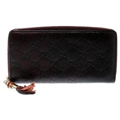 Gucci Burgundy Guccissima Leather Bamboo Tassel Zip Around Wallet