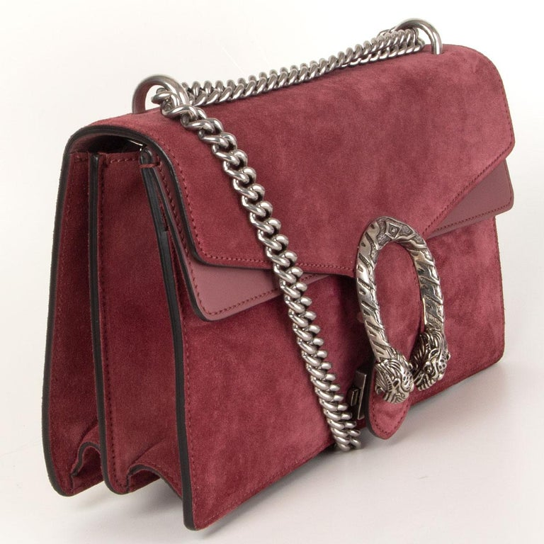Gucci 'Small Dionysus' shoulder bag in dust burgundy suede and calfskin embellished with a silver-tone tiger's head clasp - it's inspired by the ancient Greek god Dionysus. Opens with push clasp-fastening front flap and is lined in dusty rose