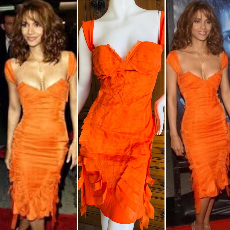 Gucci by Tom Ford  orange ribbon dress 2004 . Appears in Tom Ford book twice, in orange/red. This is classic Tom Ford, sexy coming and going.  Size 38  Bust 34
