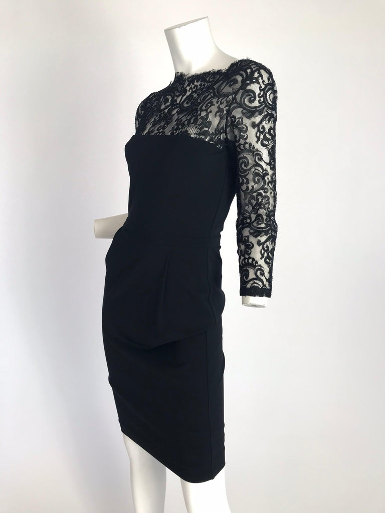 Black Gucci by Tom Ford lace long sleeve dress with bateau neck and concealed zip closure at back. Condition: Excellent. Size Small   Waist: 26