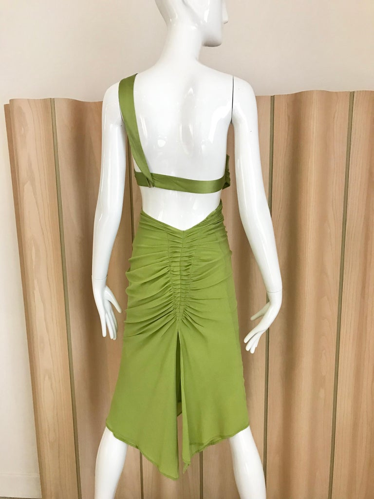 Green Gucci by Tom Ford cut out silk dress.  Marked size 40 but it fit small than 40.  Best to fit size 0 or 2 US size See exact measurement below: Bust: 30 inches/ waist: 24 inches/ Hip 32 inches/ Dress length 45 inches/