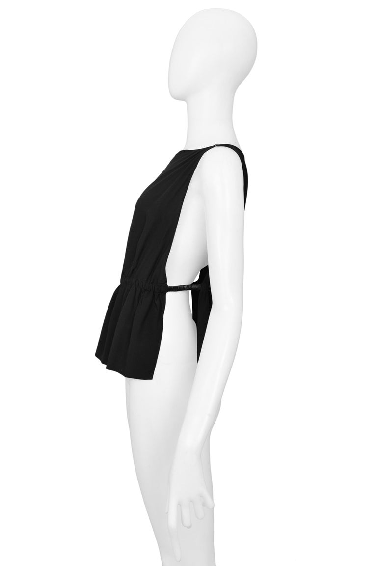 Resurrection Vintage is excited to offer this stunning vintage Tom Ford for Gucci black silk top featuring sexy open side panels with leather bands at the sides.   Gucci Designed by Tom Ford Size 42 Silk 1999 Collection Excellent Vintage