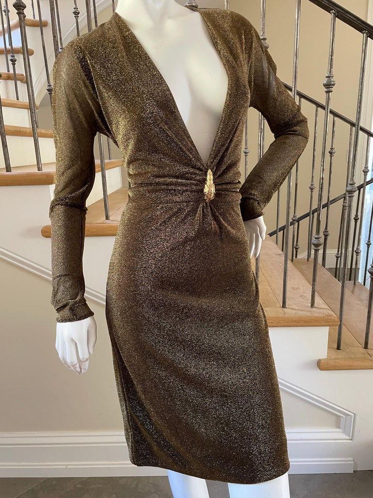 Gucci by Tom Ford Sheer Gold Dress with Dragon Ornament. This is such a pretty dress, and has a lot of shimmer, and stretch. This dress has the bust stitched high, as it was often sold, but it also came low cut. I call this version the modest