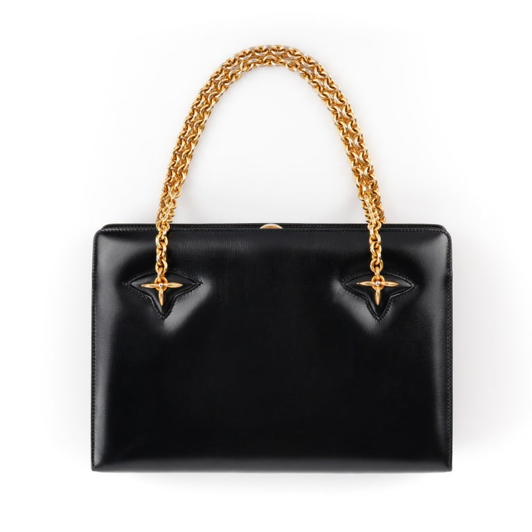 GUCCI c.1960's Black Leather Gold Chain Link Push Lock Handbag RARE   Circa: 1960's  Label(s): Gucci  Style: Handbag Color(s): Black Lined: Yes Unmarked Fabric Content: Leather  Additional Details / Inclusions: Black structured handbag; attached