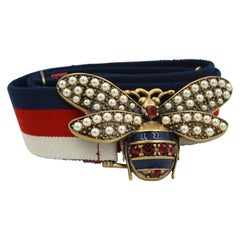 Gucci canvas Belt with the bee buckle made of stone and fake pearls.