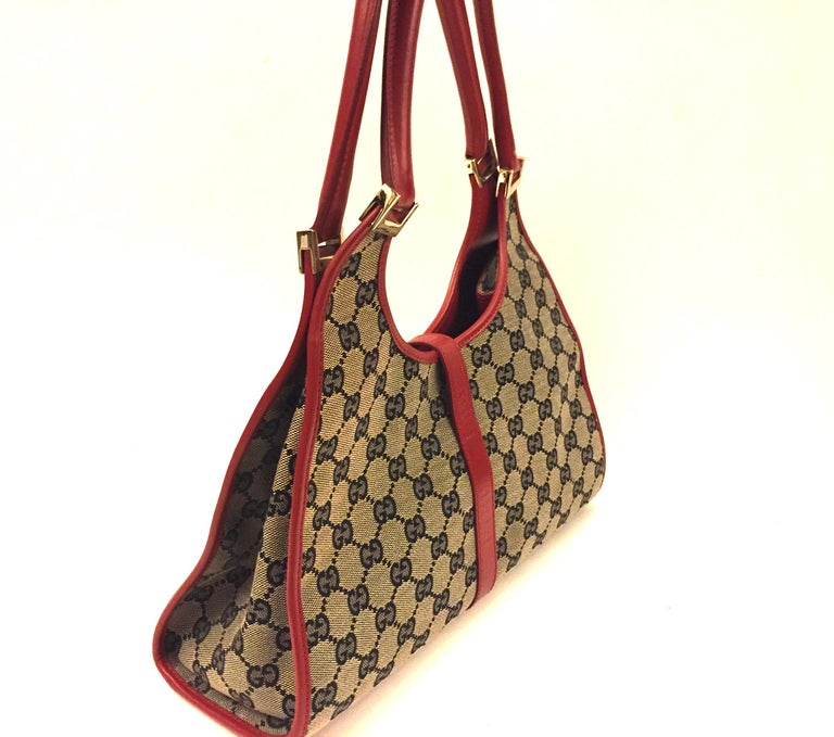 Brown Gucci canvas monogram red piping handbag For Sale
