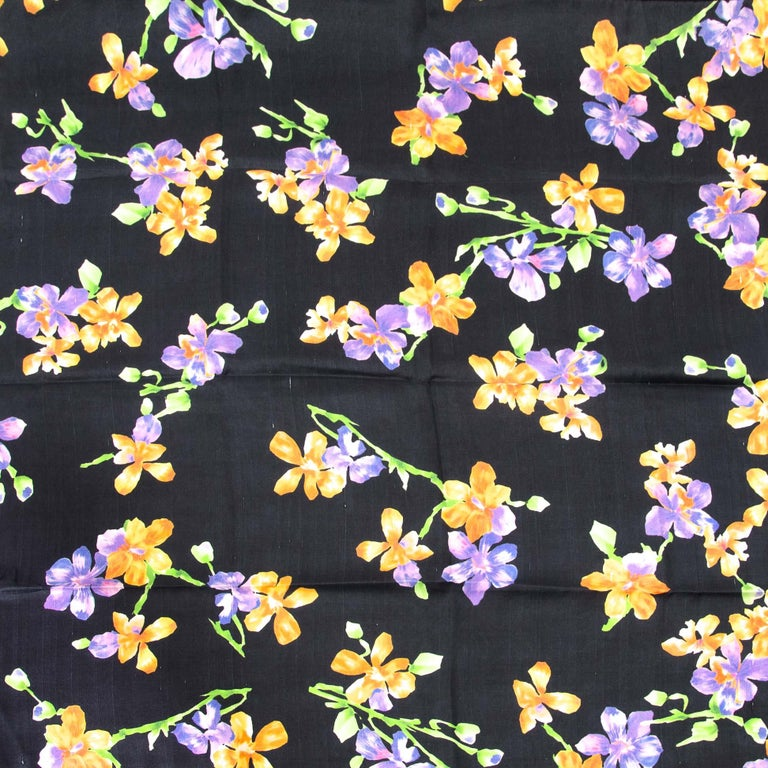 In good preloved condition  Gucci Carré Silk Flower Scarf  This beautiful Gucci Carré Silk Flower Scarf comes in black with orange and purple flowers.  100% silk  Care label attached