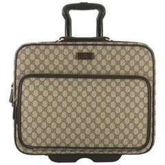 f13c75b10 Gucci Carry On Trolley Rolling Luggage GG Coated Canvas With Leather