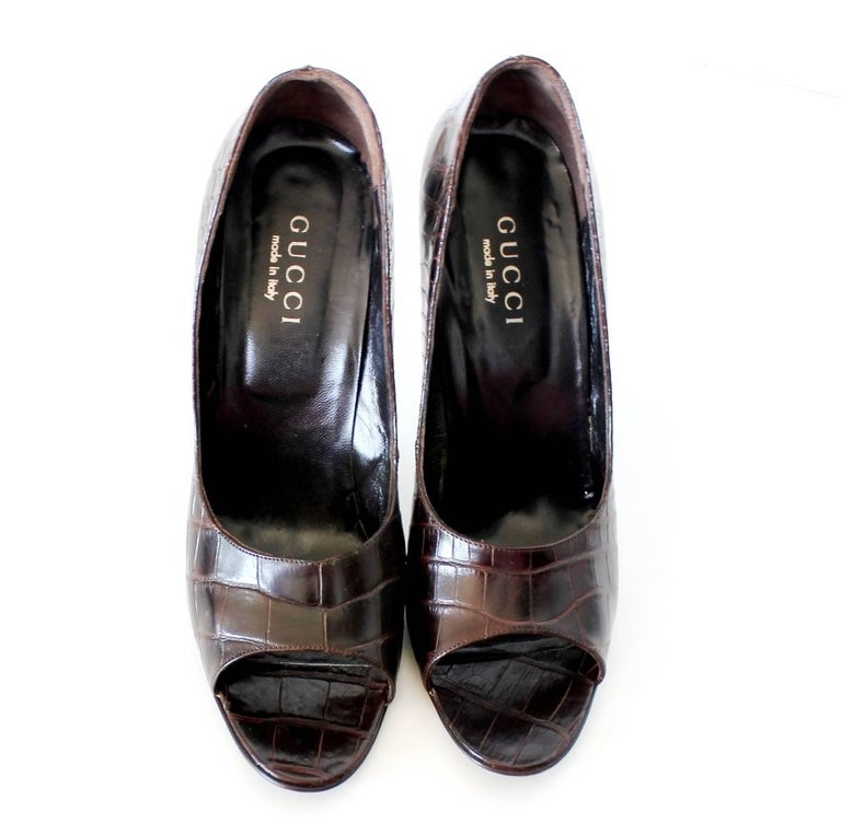 GORGEOUS GUCCI CHOCOLATE BROWN  HIGH HEEL PEEP TOE  MADE OUT OF REAL ALLIGATOR SKIN - NO PRINT!  DETAILS:  A GUCCI signature piece that will last you for years Perfect for the coming summer Beautiful brown alligator skin of the highest quality