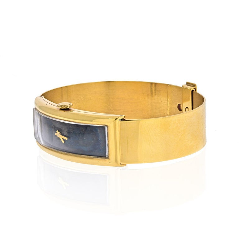 Gucci Circa 1970's 18K Yellow Gold Vintage Rectangular Watch. Up to wrist size 7.5 inches.