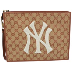 Gucci clutch in monogram canvas – New York Yankees collection.