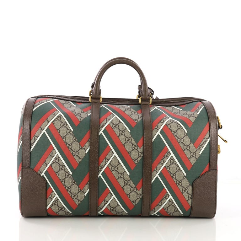 d768988f08da Gucci Convertible Duffle Bag Printed GG Coated Canvas Medium In Excellent  Condition For Sale In New