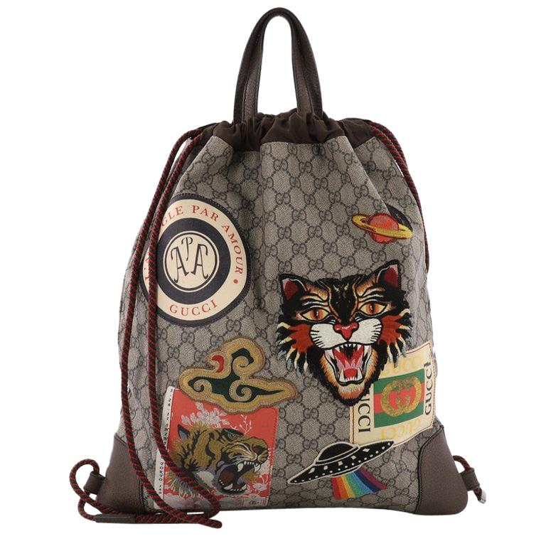 a01ded2a04f Gucci Courrier Soft Drawstring Backpack GG Coated Canvas with Applique  Medium For Sale