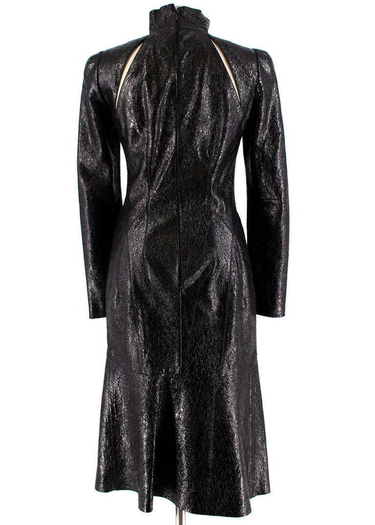 Gucci Crackled Patent Leather High Neck Dress  - Cracked Texture  - Two Back Shoulder Cut Out Slits  - Long Sleeved  - Padded Shoulders  - Lined  -  Concealed Back Zip Fastening   Material: - 74% Acetate  - 20% Silk  - Professional Leather Clean