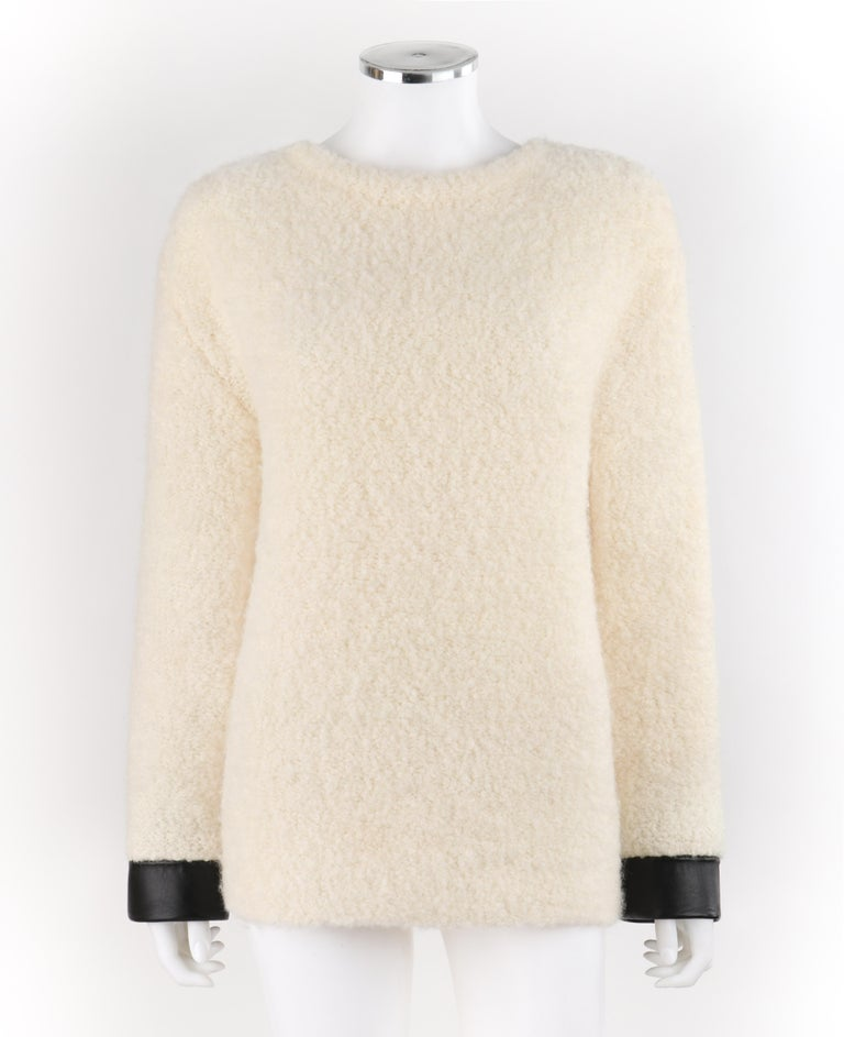 GUCCI Cream Boucle Alpaca Wool Knit Leather Cuffs Oversize Pullover Sweater   Estimated Retail: $1,630   Brand / Manufacturer: Gucci  Style: Sweater Color(s): Cream & Black  Lined: No       Marked Fabric Content: 61% Wool, 35% Alpaca, 4% Nylon