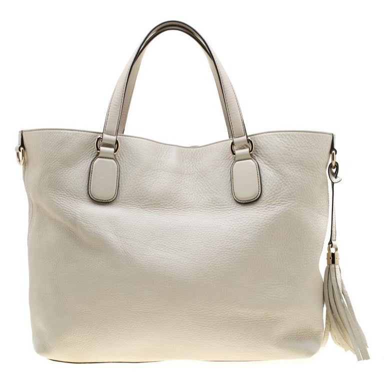 This Soho Working tote is one of the many designs by Gucci that is loved by women worldwide. The bag is constructed from cream-colored leather and designed with the signature GG on the front. It features a spacious canvas interior for your