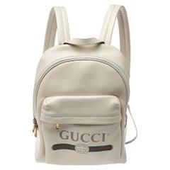 Gucci Cream White Leather Gucci Print Backpack