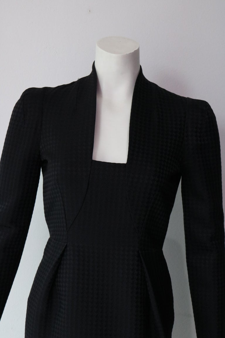 Chic and elegant black dress 86% wool  14% silk  Size 40 (fits smaller)  Made in Italy  Retail Price $2,500 Mint Condition