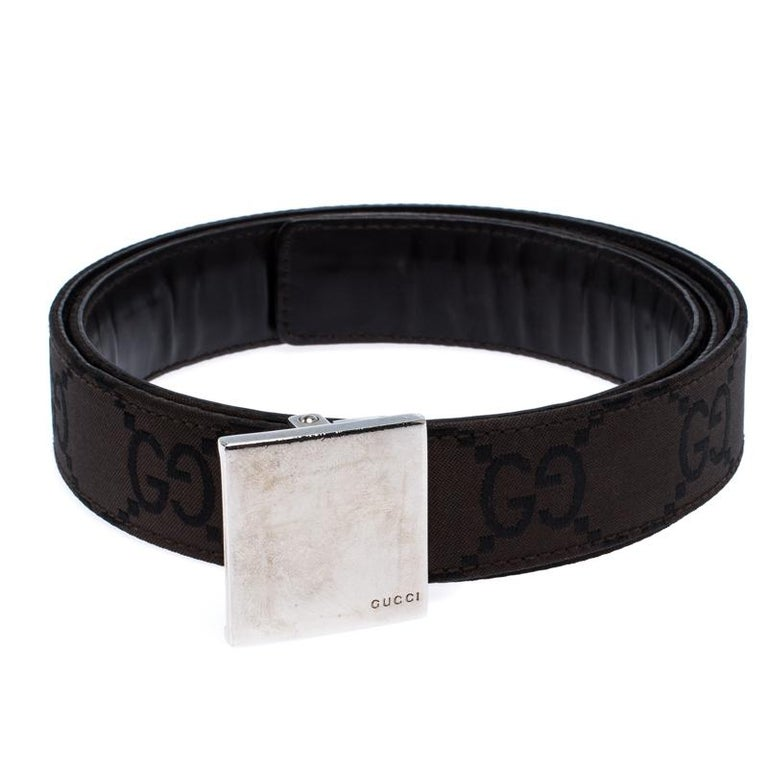 Add a luxe twist to your attire with this belt from Gucci. Made from GG fabric, this dark brown belt comes with a complementing silver-tone logo plaque. It is durable and high in style.  Includes: The Luxury Closet Packaging