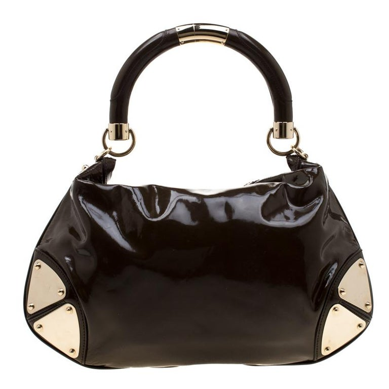 We bring you this exclusively designed bag made from patent leather. Ever wondered why Gucci is one of the unequalled options for bags? This Babouska Indy bag is probably why. It has two bamboo detailed tassels and a spacious fabric interior. The
