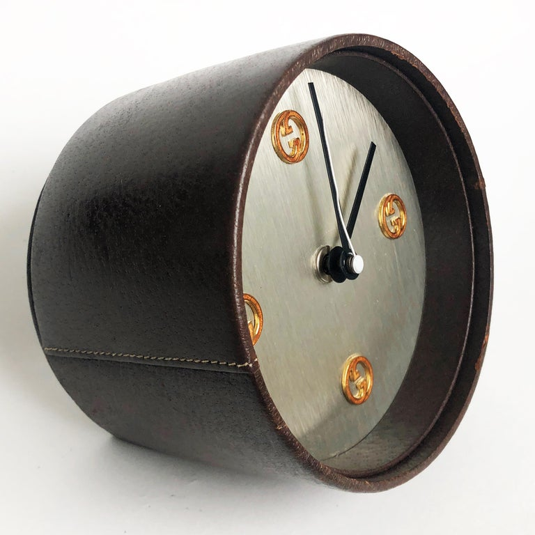 Authentic, preowned, vintage Gucci desk clock, circa the early 1980s. Covered in pigskin leather, with GG logo motif hour markings. This piece originally came with a battery operated movement by well-known German clock maker, KIENZLE, however it was