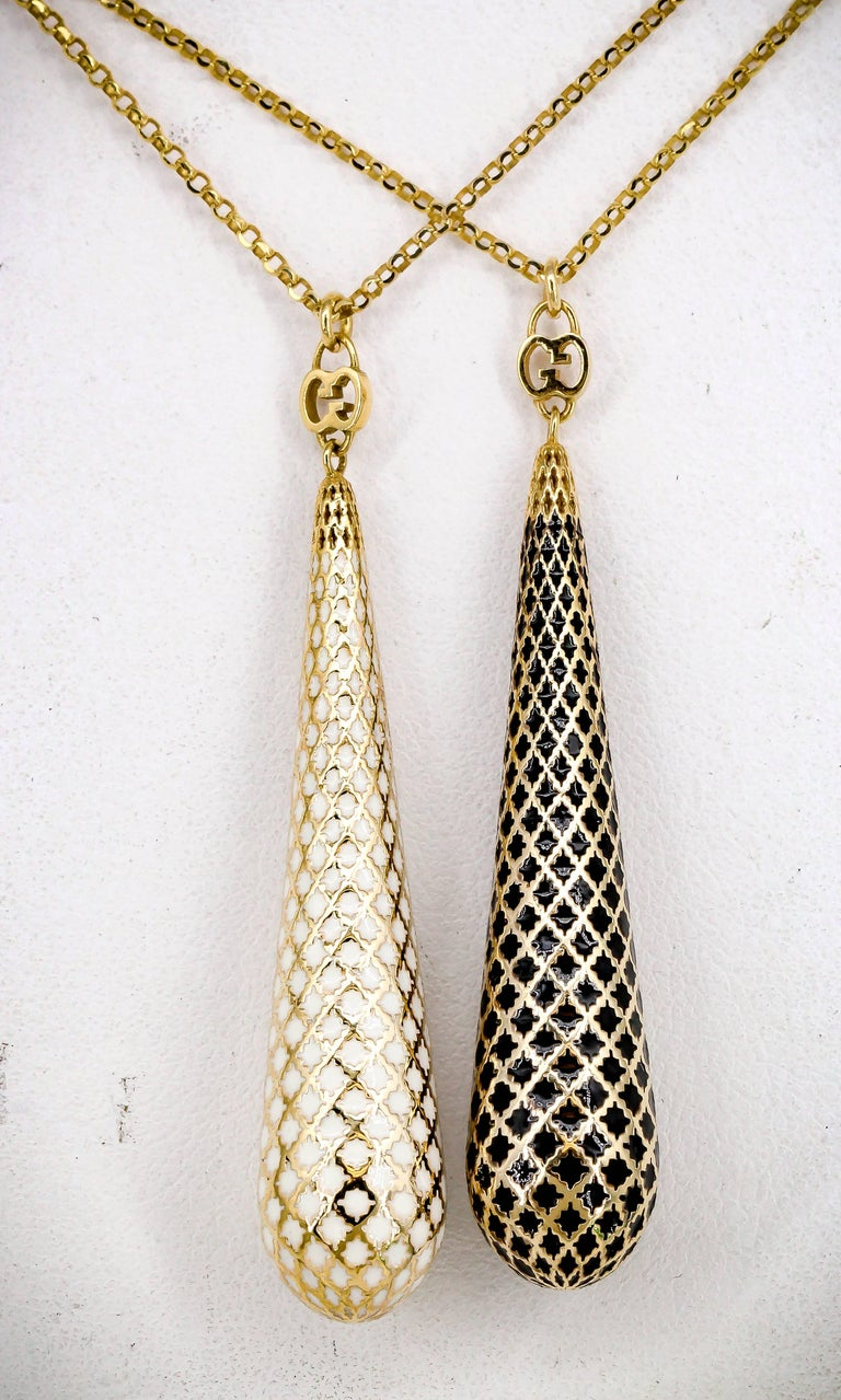 Elegant pair of enamel and gold pendant necklaces from the