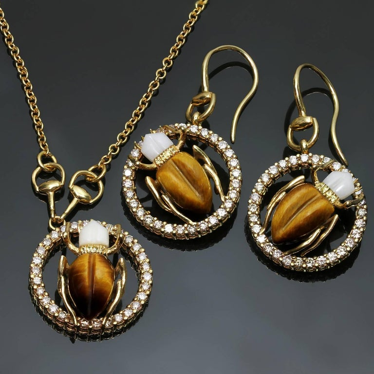 edaaa873925 These lively and sparkling Gucci drop earrings   pendant necklace set  feature a scarab beetle design
