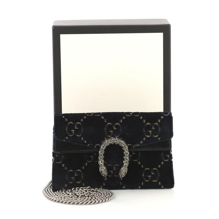 6ee93e5cb This Gucci Dionysus Bag GG Velvet Super Mini, crafted from blue GG Velvet,  features