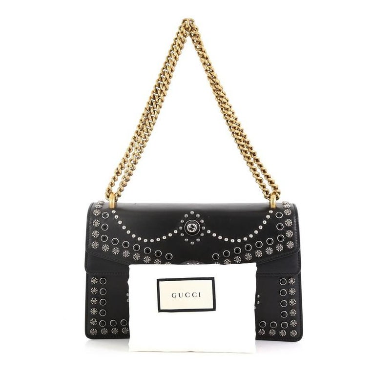 0d79da63146 This Gucci Dionysus Bag Studded Leather Small, crafted in black studded  leather, features a