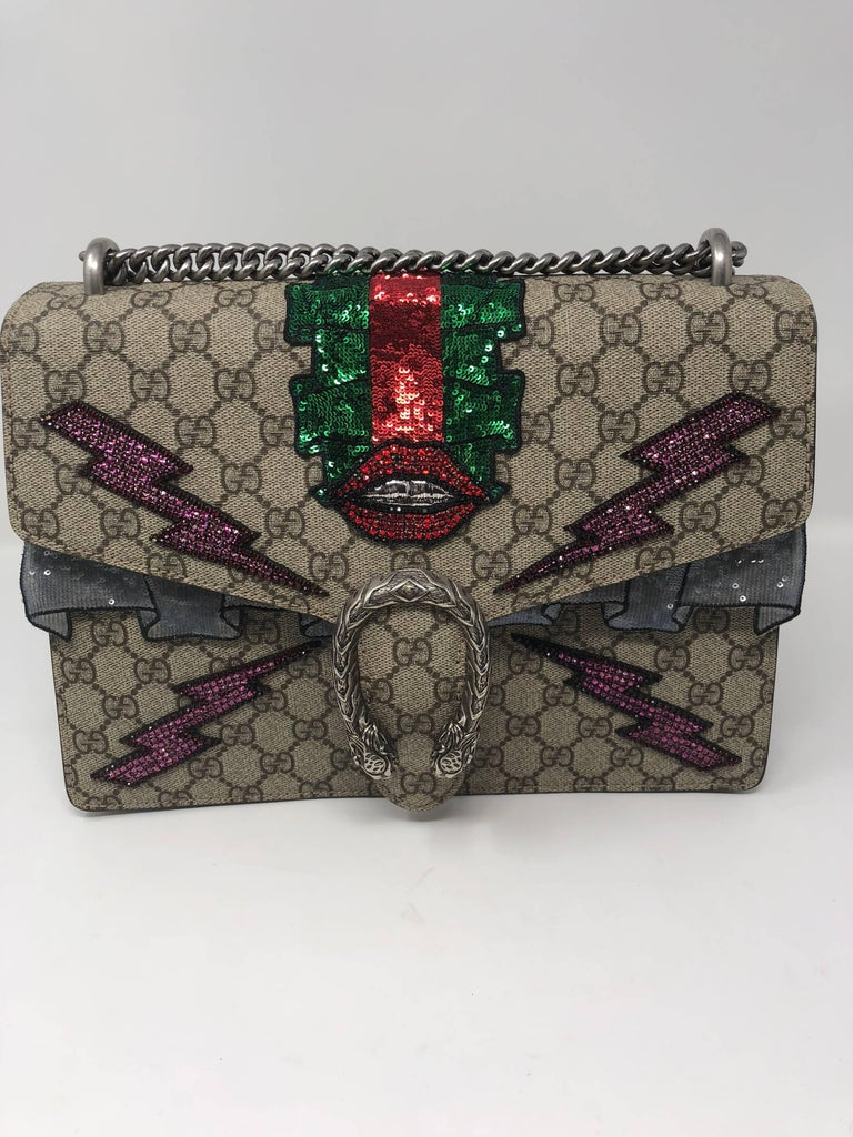 bf42b1fb383 Gucci Dionysus GG shoulder bag with textured tiger head closure with hand-embroidered  sequin appliques
